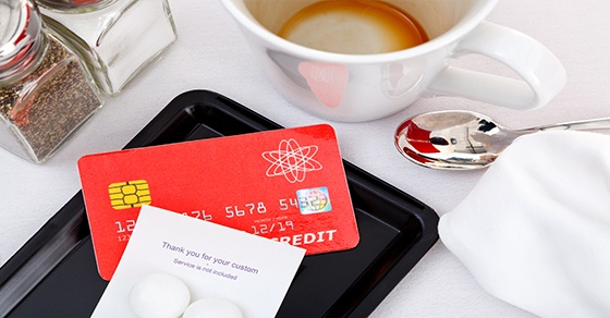 restaurant check and credit card