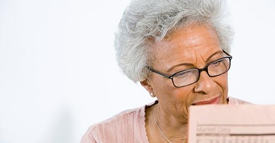 senior woman looking at paperwork