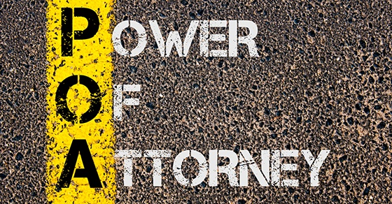 Concept image of Business Acronym POA as Power Of Attorney written over road marking yellow painted line.