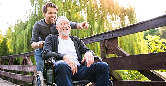 man and father in wheelchair